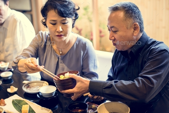 Japanese family dining together with happiness - Stock Photo - Images