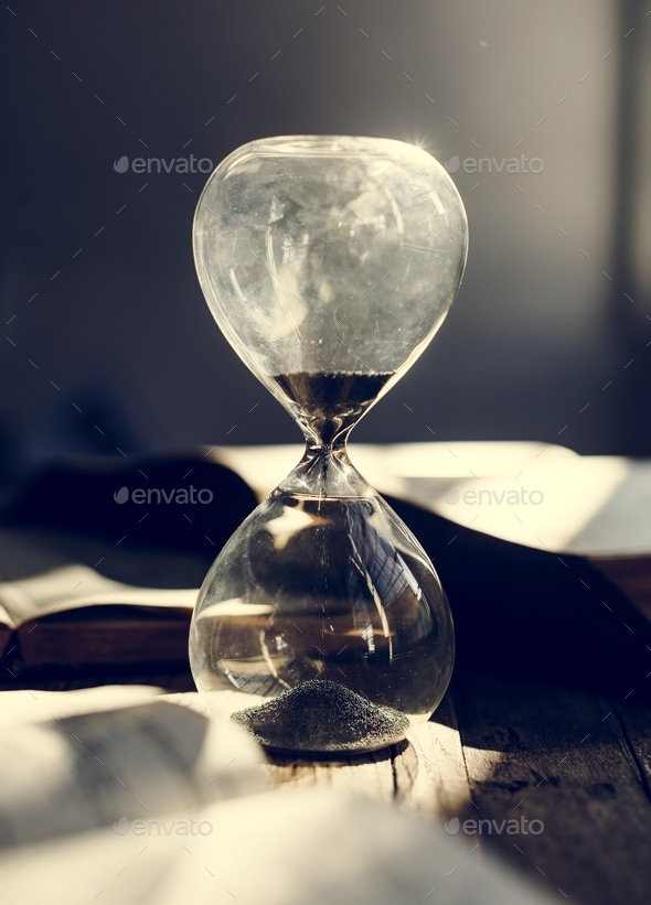 Sandglass on a table - Stock Photo - Images