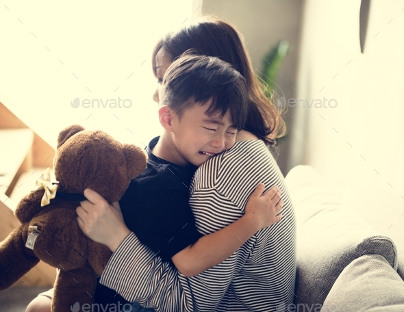 Japanese mother comforting her son - Stock Photo - Images