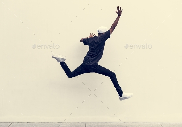 African man jumping - Stock Photo - Images