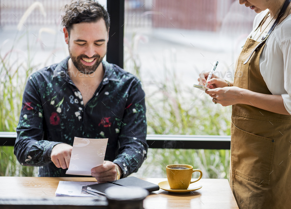 Man ordering food at the restaurant - Stock Photo - Images