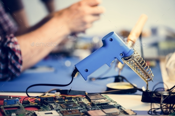 Side view of soldering tool on technician workshop - Stock Photo - Images