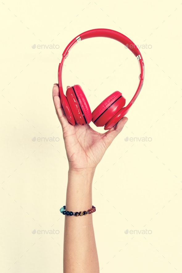 Hand holding headphone isolated on background - Stock Photo - Images