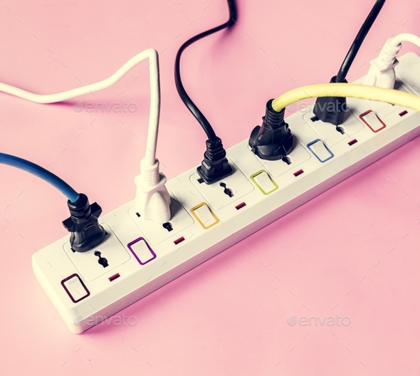 Fulled electrics power supply plug on pink background - Stock Photo - Images