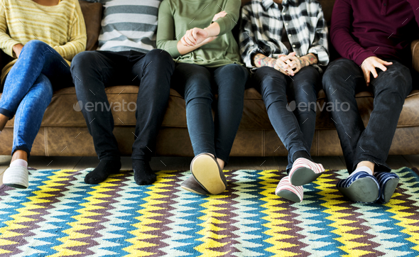 Group of people sitting on couch together - Stock Photo - Images