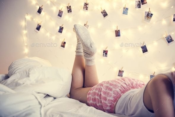 Legs with photos hanging on decoration lights - Stock Photo - Images