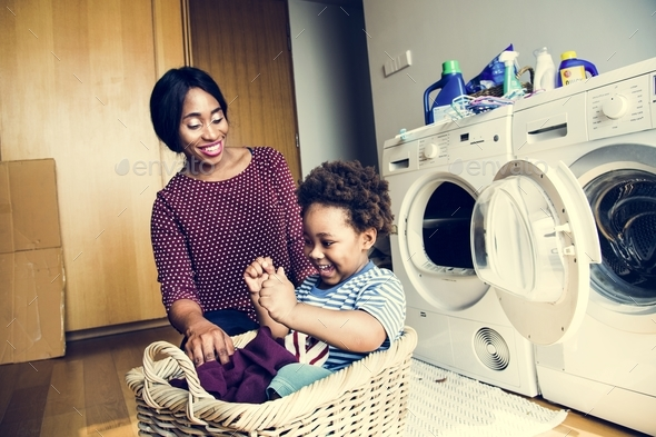Mother and son doing housework together - Stock Photo - Images