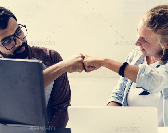 Men and woman make a fist bump together - Stock Photo - Images