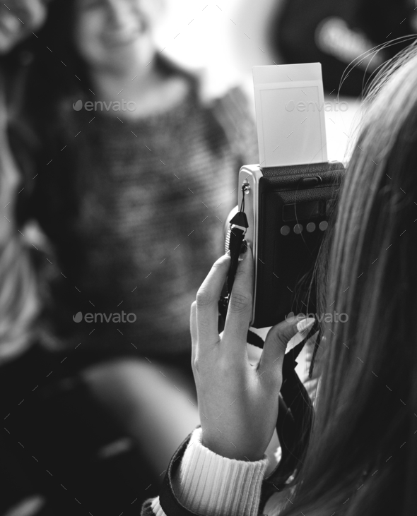 Teenager taking a picture of her friends hobby and photography concept - Stock Photo - Images