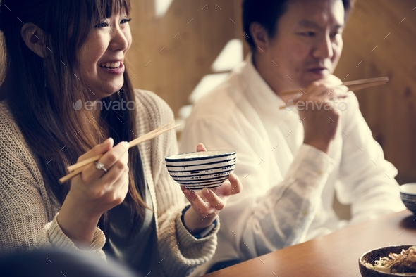 Japanese husband and wife eating - Stock Photo - Images