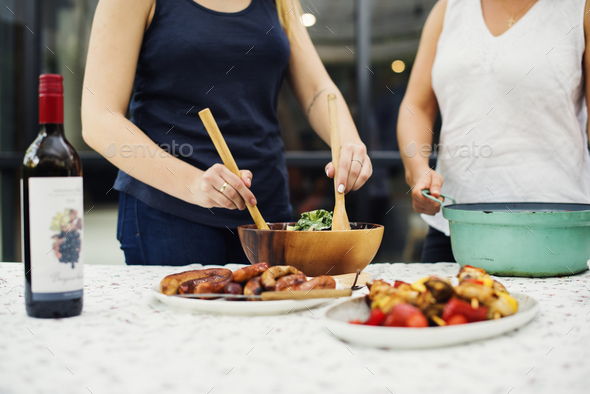 People preparing food for party - Stock Photo - Images