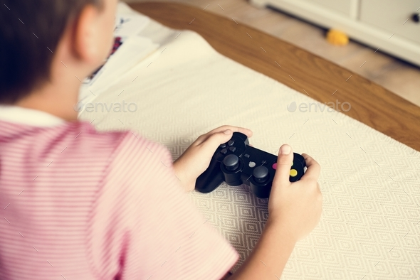Young boy playing game - Stock Photo - Images