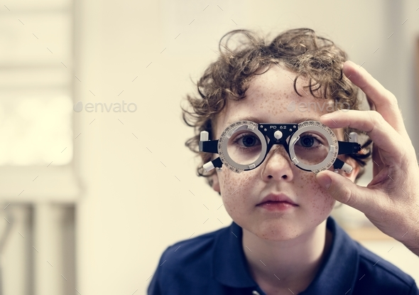 Little boy getting his eyes checked - Stock Photo - Images