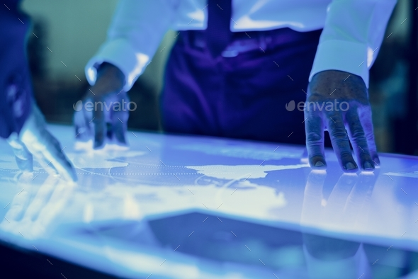 Hands point a cyber space diagram table in a meeting - Stock Photo - Images