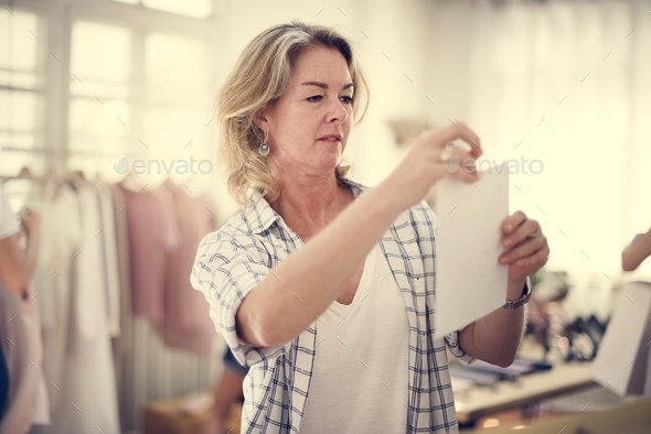 Shop owner sorting out some stuff - Stock Photo - Images