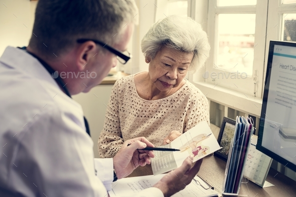 Old woman having a checkup - Stock Photo - Images