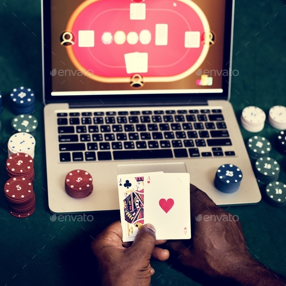 Hand holding card playing online gambling - Stock Photo - Images