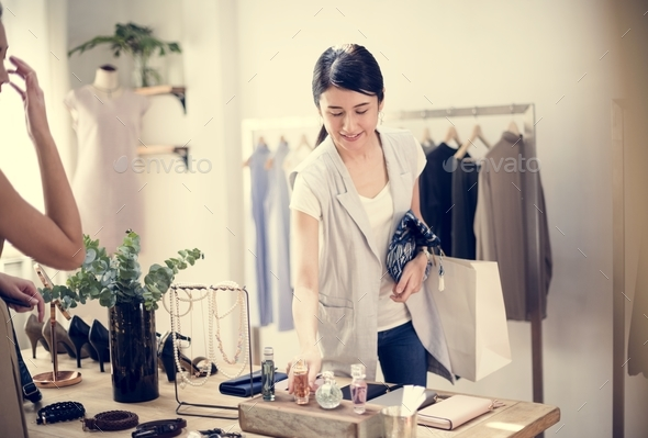 Customer checking out clothes - Stock Photo - Images