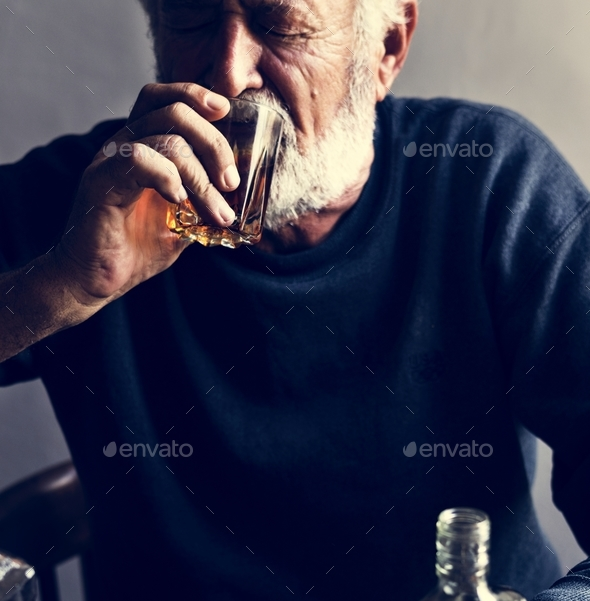 Elderly man drinking alcohol - Stock Photo - Images