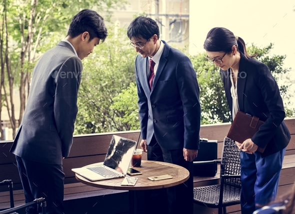 Business people greeting bowing gesture - Stock Photo - Images