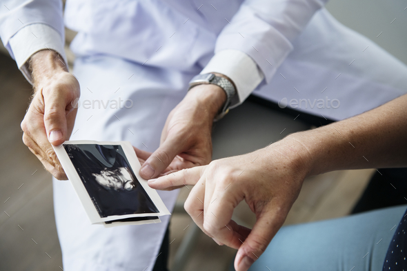 Pregnant woman having fetal monitoring by doctor - Stock Photo - Images