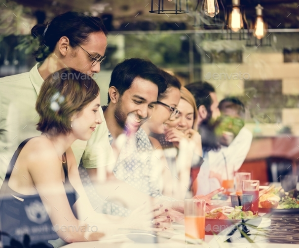 Diverse friends together in the restaurant - Stock Photo - Images