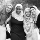 Group of islamic friends embracing and smiling together - PhotoDune Item for Sale