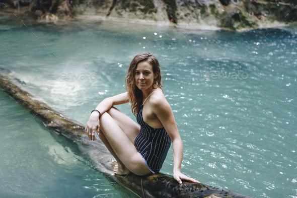 White woman enjoying the waterfall - Stock Photo - Images