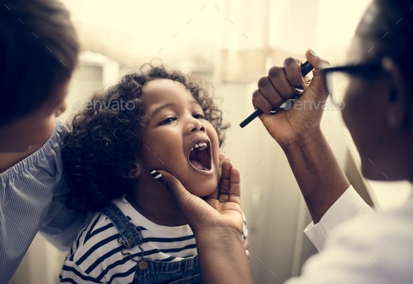 Little girl having her teeth checked - Stock Photo - Images