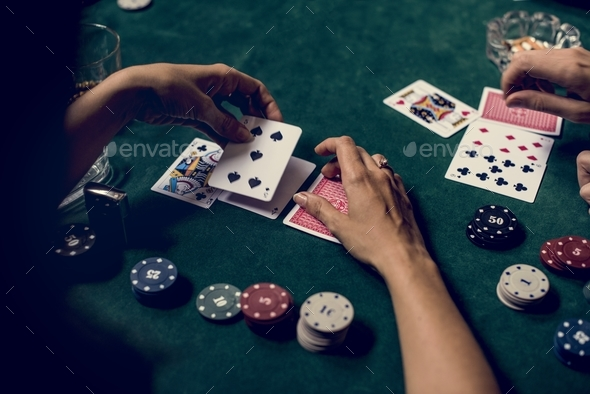 Hands holding card on gambling game - Stock Photo - Images