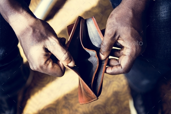 Man checking his empty wallet - Stock Photo - Images