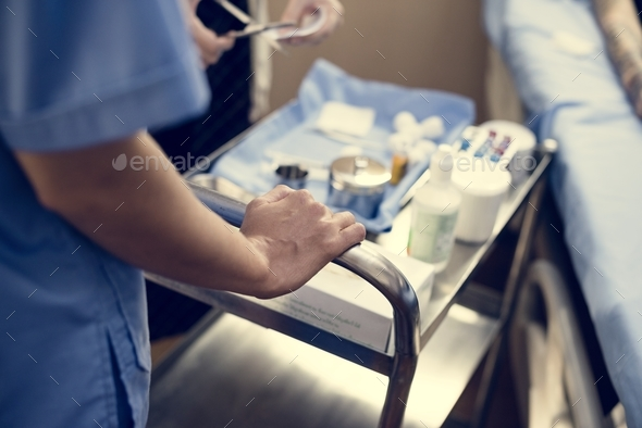 Nurse preparing medical equipments - Stock Photo - Images