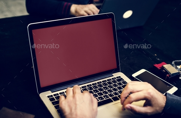 Closeup of hand with computer laptop background - Stock Photo - Images