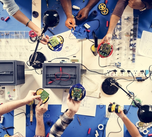 Technician team working at electronics repair shop - Stock Photo - Images