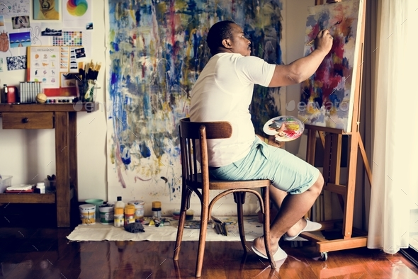 Black artist man doing artwork - Stock Photo - Images