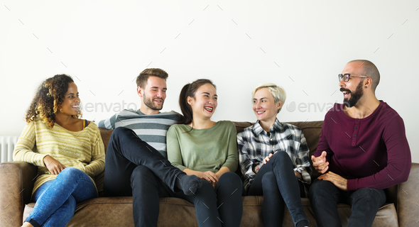 People sitting on couch together - Stock Photo - Images