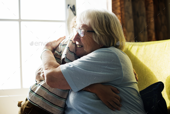 Grandma and grandson hugging together - Stock Photo - Images