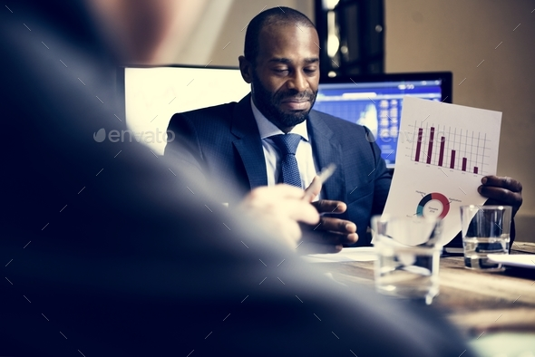 Group of diverse business people having a meeting together - Stock Photo - Images