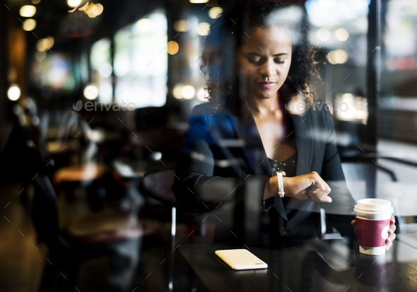 Woman waiting at a cafe - Stock Photo - Images