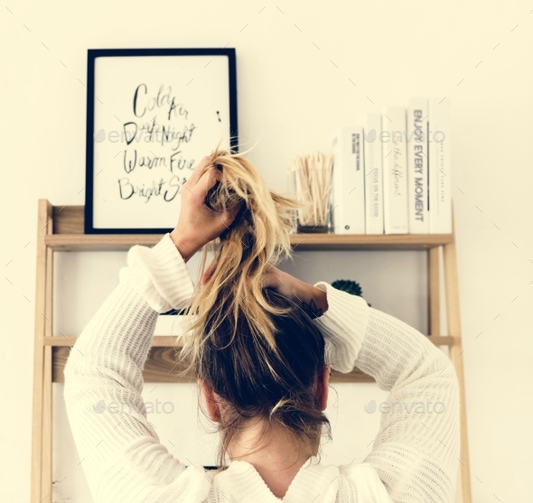 Rear View of a Woman Tying Her Hair Up - Stock Photo - Images