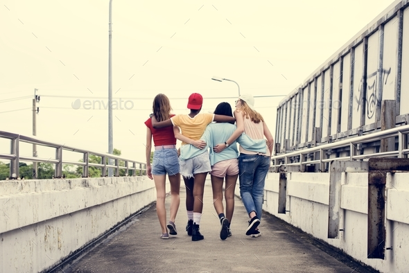 Rear view of diverse women walking together - Stock Photo - Images
