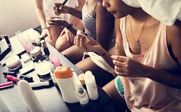 A diverse group of women preparing and using makeups - Stock Photo - Images