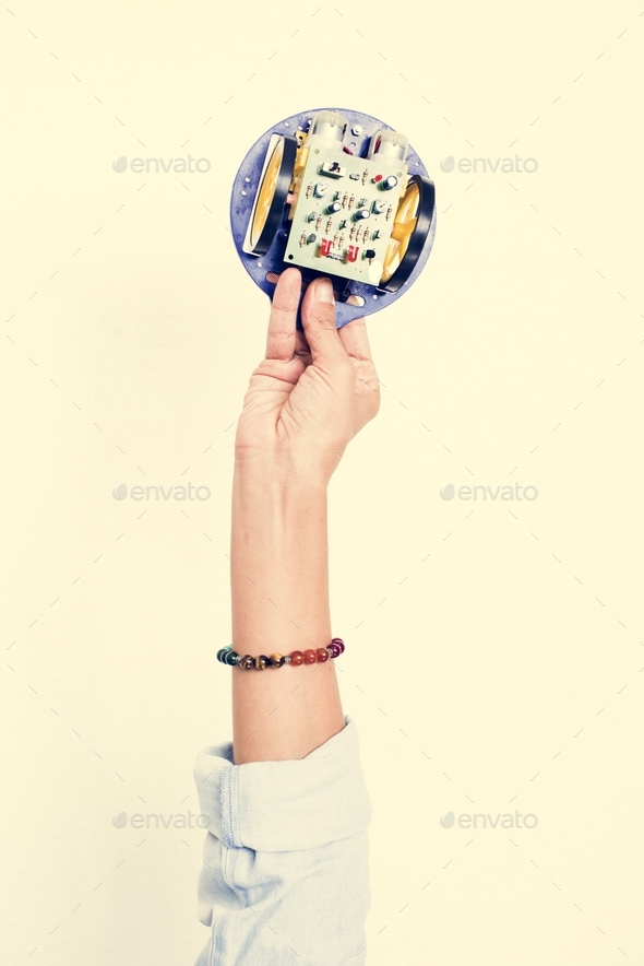 Hand holding motherboard circuit hardware part - Stock Photo - Images