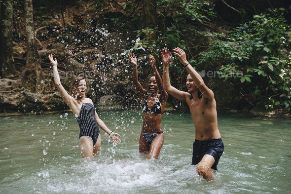 Group of diverse friends enjoying the waterfall - Stock Photo - Images