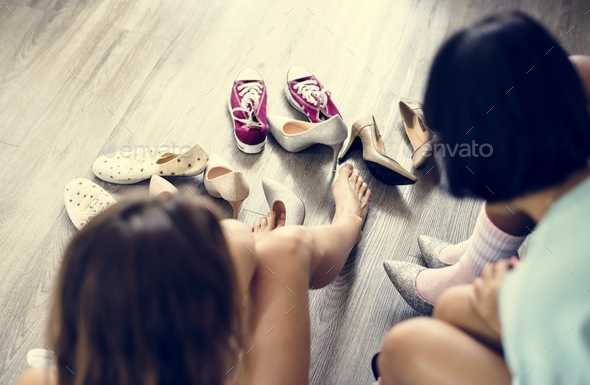 Women trying on new shoes - Stock Photo - Images
