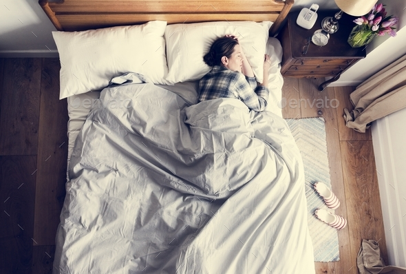 Caucasian woman on bed sleeping - Stock Photo - Images
