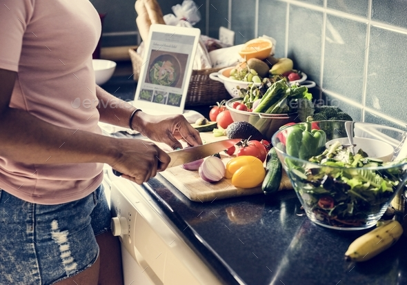 Black woman cooking in the kitchen - Stock Photo - Images