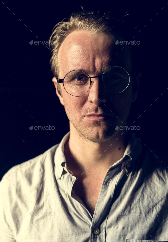 Caucasian man with eyeglasses look worries - Stock Photo - Images