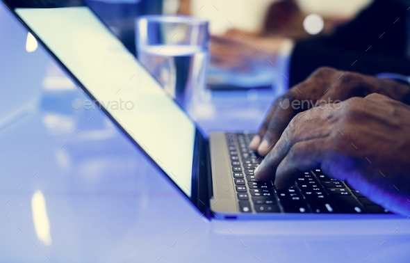 Hand on a laptop working at cyber space table - Stock Photo - Images