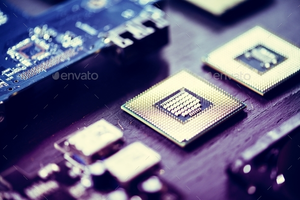 Closeup of electronics computer components microprocessors mainboard - Stock Photo - Images